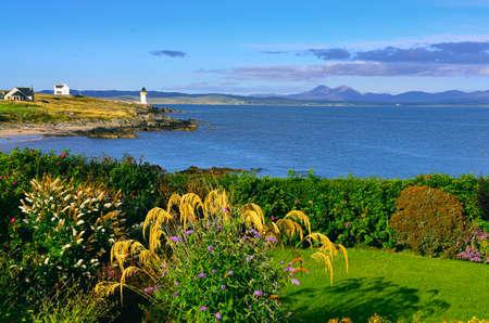 Ocean coast lighthouse in Port Charlotte, Scotland, United Kingdom