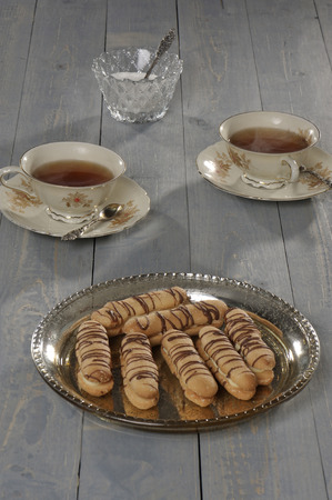 gastronome: Homemade cookie with coffee cups on wooden table