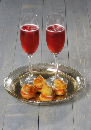silver tray: Stuffed profiterole with welcome drinks on a silver tray