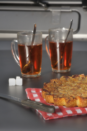 gastronome: Homemade cranberry cake with almond with two glasses of tea