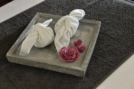revitalize: Wellness tray with towels and hot stone inside.