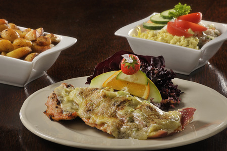 fried potatoes: Fish with melted cheese, fried potatoes and salad