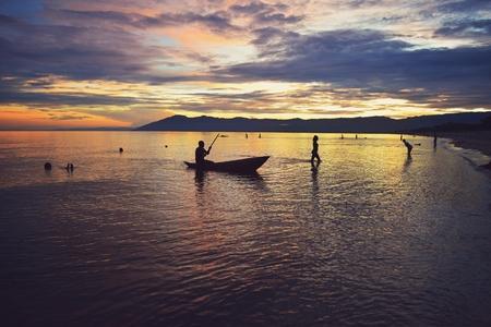 Golden hour at Kande Beach, Nkhata Bay, Lake Malawi Stock Photo - 108172377
