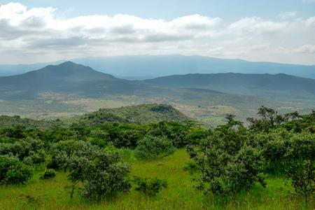 Savannah grasland against a mountain background, Oloroka Montain Range,Kenya Reklamní fotografie