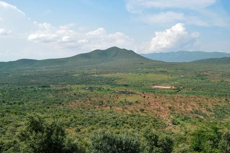 Savannah grassland against a mountain background, Oloroka Mountain Range, Kenya