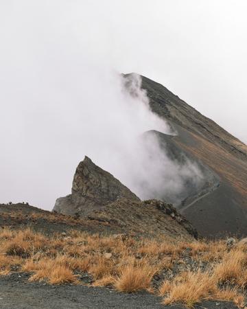 Mount Meru partly covered by clouds, Arusha National Park, Tanzania Reklamní fotografie