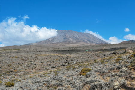 Mount Kilimanjaro against the background of a a blue sky Stock Photo
