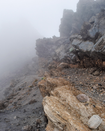 Rock formations above the clouds at Mount Meru, Arusha National Park, Tanzania