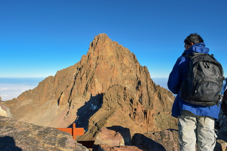 A hiker against Batian Peak, Mount Kenya Editorial