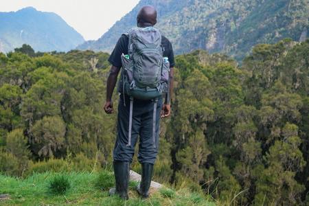 A hiker against a mountain background, Rwenzori Mountain, Uganda