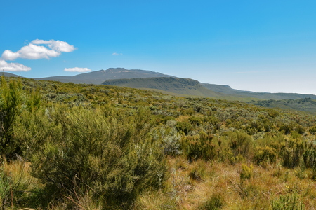 Mountain landscapes against a blue sky at Chogoria Route, Mount Kenya