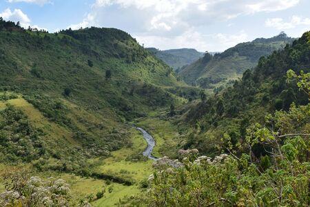 A scenic rural landscape against a mountain background in rural Kenya, Aberdare Ranges, Kenya