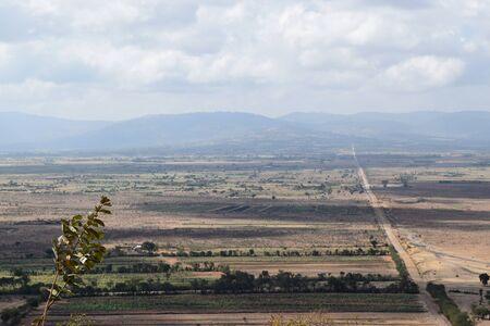 Scenic flat arid landscapes against sky in rural Kenya Stock Photo
