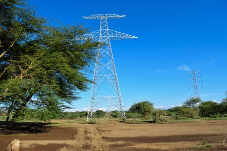 Electricity transmission lines agasinst a blue sky in rural Kenya, Suswa Conservancy
