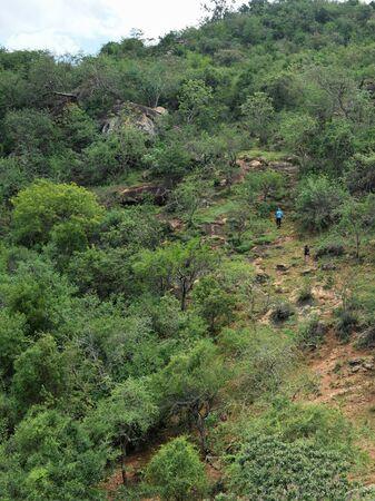 A high angle view of hikers against mountain, Namanga Hills, Kenya