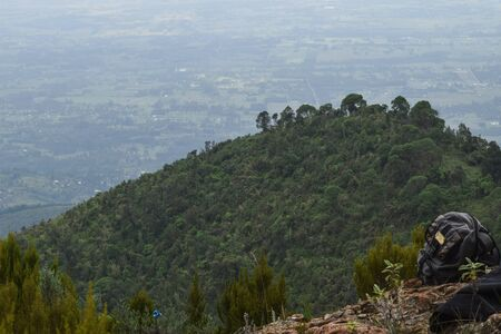 A backpack against a scenic mountain landscapes in rural Kenya, Aberdare Ranges