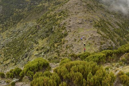 A high angle of hikers against a mountain, Aberdare Ranges, Kenya Stock Photo