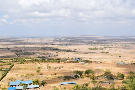 High angle view of arid landscapes against sky in rural Kenya, Makueni County Stock Photo