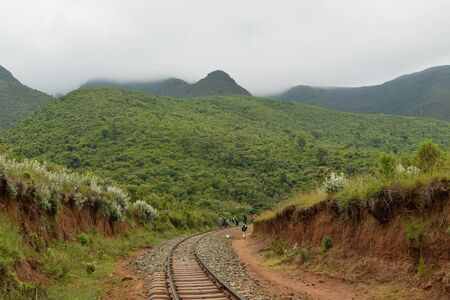 Friends hiking along the railway tracks against mountain, Kijabe Hills