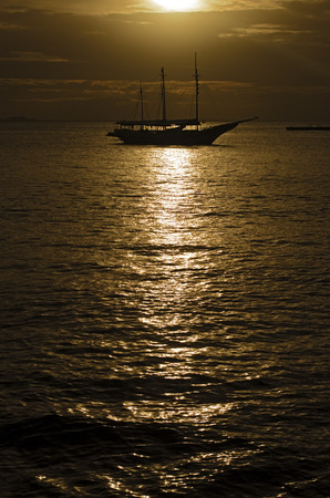 oceana: Ship silhouette against the light at sunset