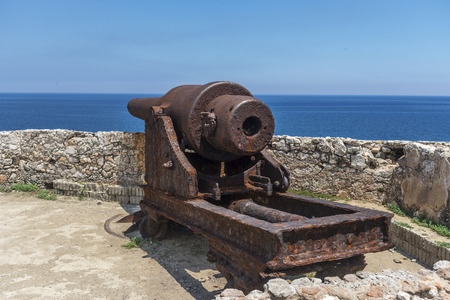 Old cannon from days of the conquest of america pointing towards the sea from a Cuban fortress