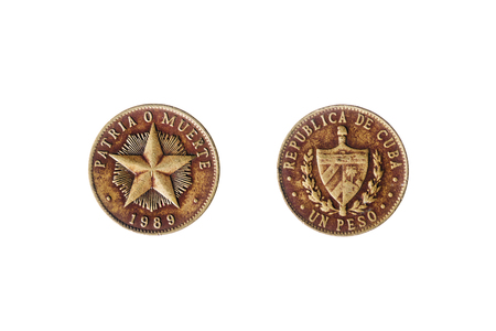 peso: Cuban peso coin with star and the words Patria o muerte