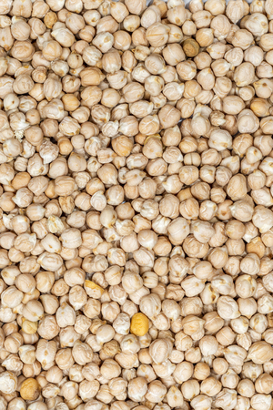 occupying: chickpea seeds occupying the entire image frame to be used as background Stock Photo