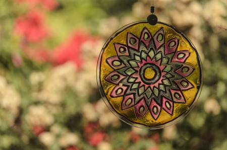 diffuse: Mandala glass with diffuse natural background garden