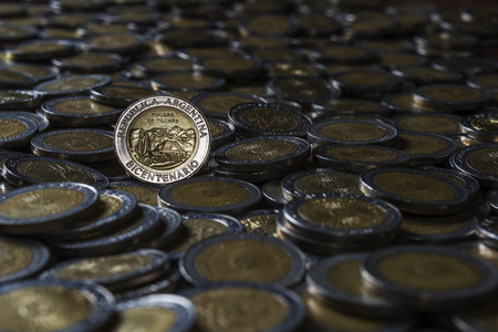 peso: one peso coin on a group of focus coins