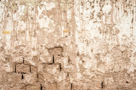 adobe wall: old adobe wall with mud stains and drippings