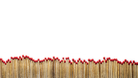 combustible: many matches at the bottom of a photo on white background