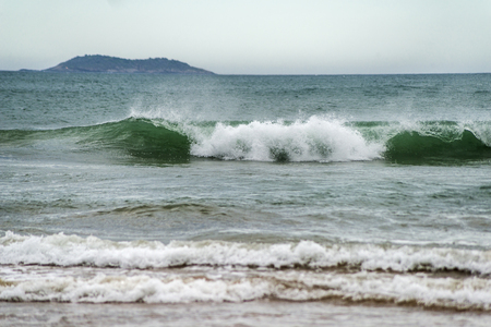 breaking waves: turbulent sea with breaking waves, foam and turquoise waters Stock Photo