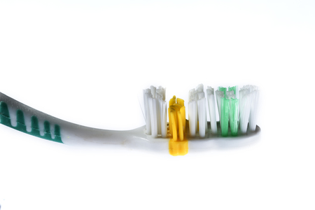 semitransparent: toothbrush of different colors on white background