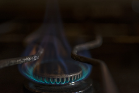 butane: burned burner from a kitchen with blue butane gas fire