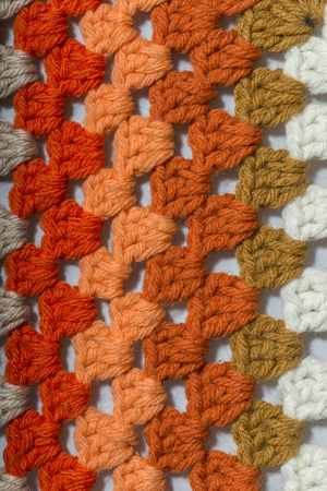 a handmade crochet fabric of different colors