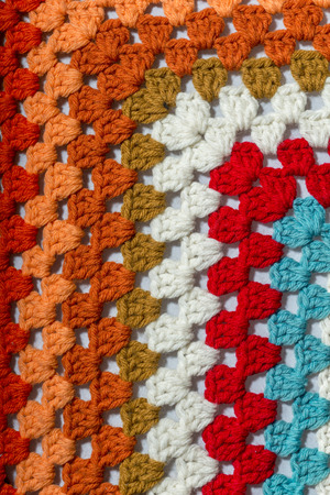 hooking: a handmade crochet fabric of different colors
