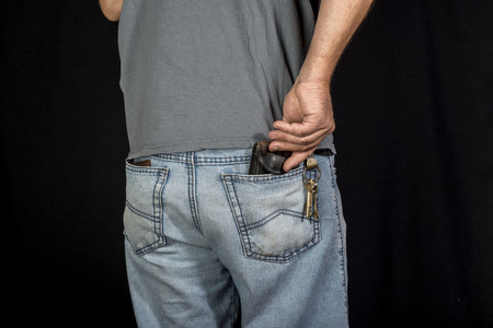 mans hand taking wallet from his own pocket