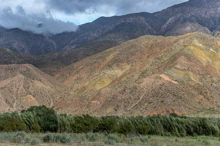 siete: view of the mountains of the Quebrada de Humahuaca with sun and shadows Stock Photo