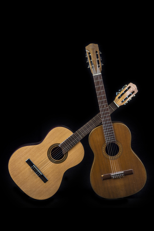 approach two Spanish guitars on black background Stock Photo