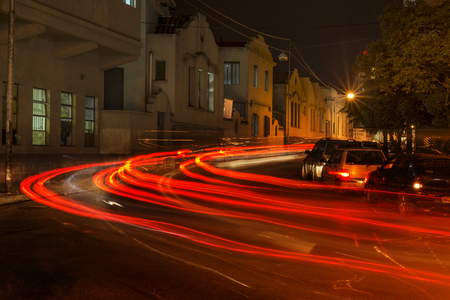 long: Traces of light left by vehicles on a city street Stock Photo