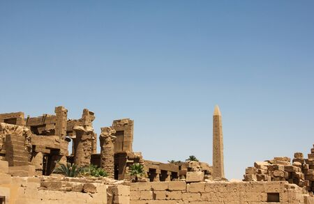 Ruins and obelisk in the complex of the Karnak temple, ancient architecture of Egypt in Luxor color photo of  landmark