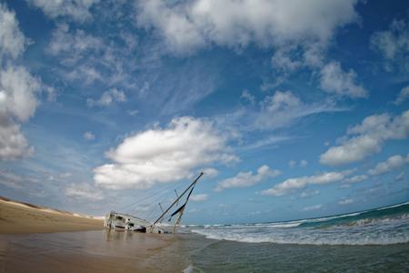 Island Boa Vista in Cape Verde, landscape - seaside with shipwreck of the sailing ship. Stock Photo