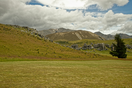 Landscape New Zealand - Arthurs Pass, Southern Alps, South Island, the highest altitude village, river with waterfalls.