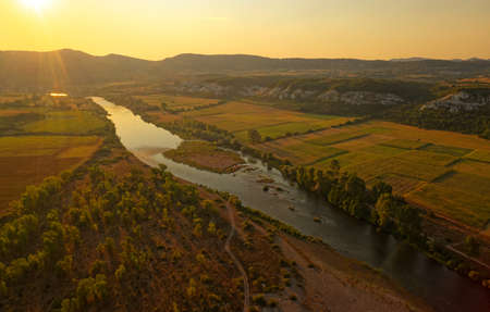 The river Arda valley in Rhodope mountains in Bulgaria during sunset. 写真素材