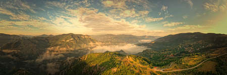 Landscape from Rhodope mountains in Bulgaria during sunset or sunrise. Small chapel and monastery near Borovo, Rhodopes.