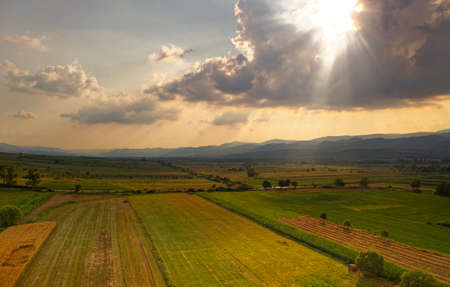 Landscape from Banat in Romania, geographical historical region between Central and Eastern Europe divided among Romania, Serbia and Hungary with several czech villages during sunset or sunrise.