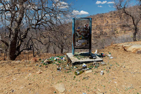 Garbage scenery in Zimbabwe, Africa with a lot of rubbish and trash. The full litter bin in nature along the road. Pollution in Africa.
