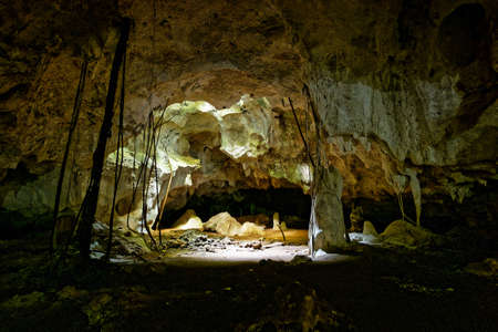 Kiwengwa Caves on Zanzibar island in Tanzania, worship locals ancestors, gifts to the holy stones, stalagmites and stalactites formed by water dissolving coral stones.