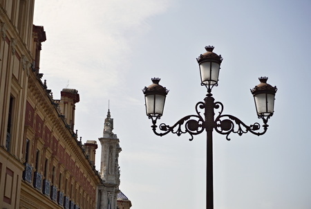Typical Spanish decorated street lamp and lantern as a symbol of antiquated Spanish design and architecture