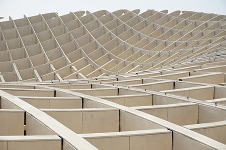 Detail of a modern roof of a contemporary building in Sevilla (Spain) made of wooden and iron boards as a symbol of futuristic architecture